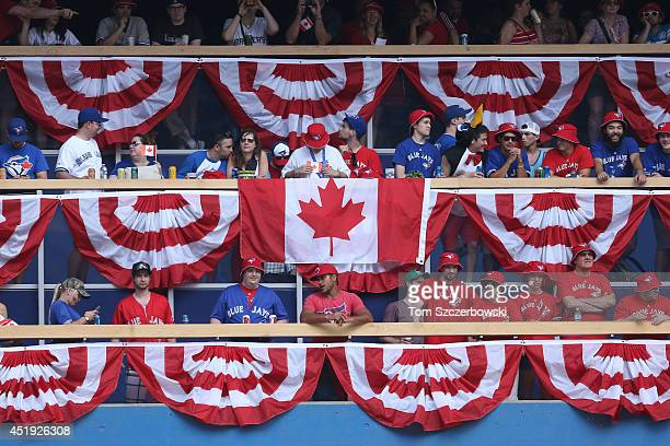 Toronto Blue Jays fans display a Canadian flag in the center field standingroom section on Canada Day during MLB game action against the Milwaukee...