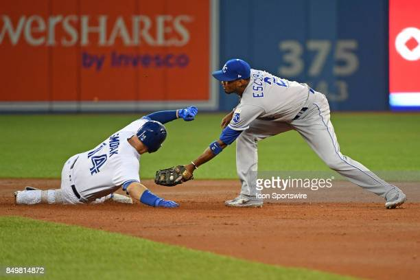 Toronto Blue Jays First base Justin Smoak beats the tag at second base from Kansas City Royals Shortstop Alcides Escobar during the regular season...