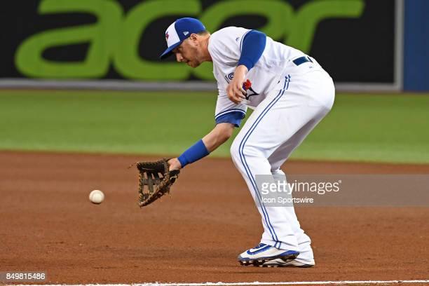 Toronto Blue Jays First base Justin Smoak fields a ground ball during the regular season MLB game between the Kansas City Royals and Toronto Blue...