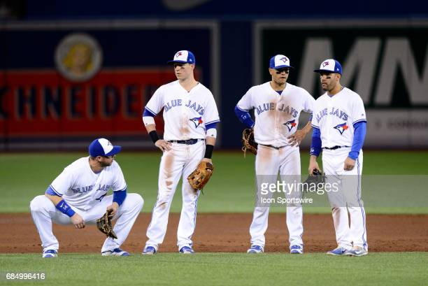 Toronto Blue Jays First base Justin Smoak Infield Ryan Goins Second base Devon Travis and Infield Chris Coghlan wait for a pitching change during the...
