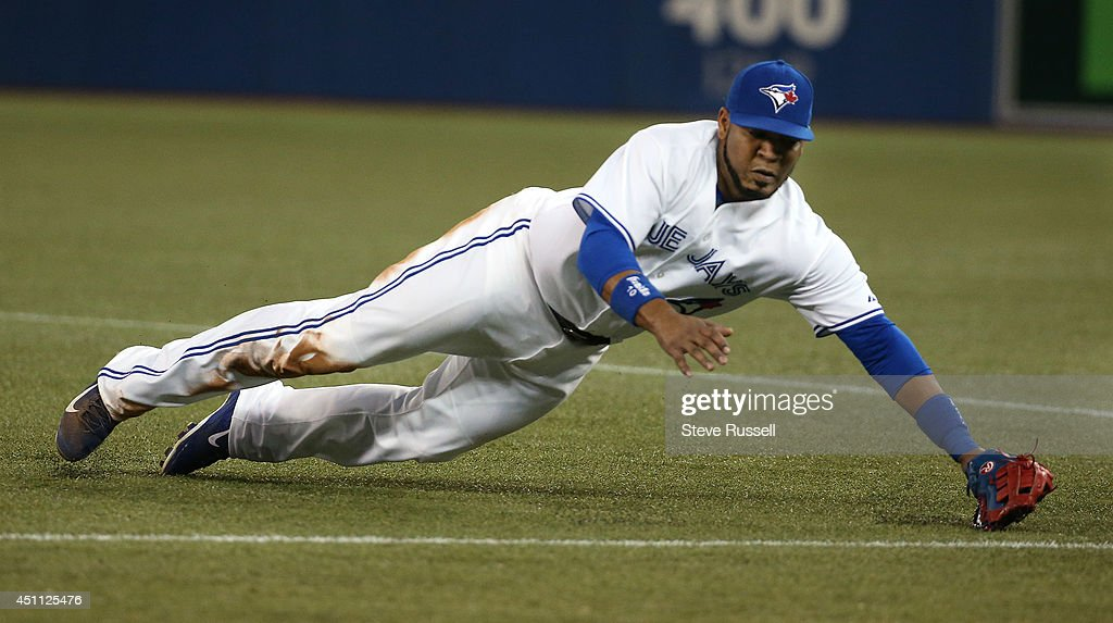 TORONTO, ON- JUNE 23 - Toronto Blue Jays first baseman Edwin Encarnacion robs a Yankee of extra bases with a diving catch on the first base line as the Toronto Blue Jays open a three game series against the New York Yankees at Rogers Centre in Toronto. June 23, 2014.