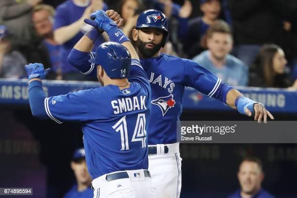 TORONTO APRIL 29 Toronto Blue Jays first baseman Justin Smoak celebrates with Toronto Blue Jays right fielder Jose Bautista after hitting a home run...