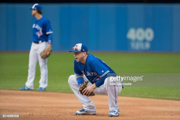 Toronto Blue Jays First baseman Justin Smoak crouches on the infield during the regular season MLB game between the Los Angeles Angels of Anaheim and...