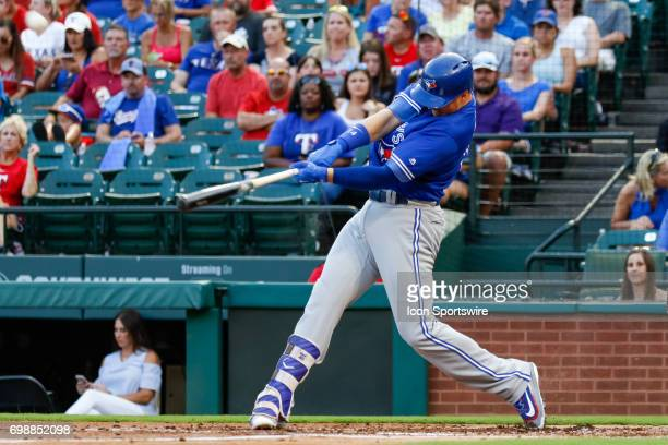 Toronto Blue Jays first baseman Justin Smoak hits a home run during the MLB game between the Toronto Blue Jays and Texas Rangers on June 19 2017 at...