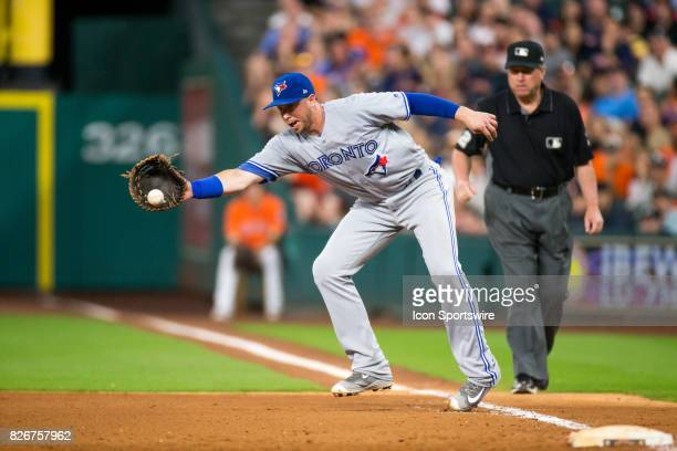 Toronto Blue Jays first baseman Justin Smoak makes a fielding play for the out in the seventh inning of a MLB game between the Houston Astros and the...