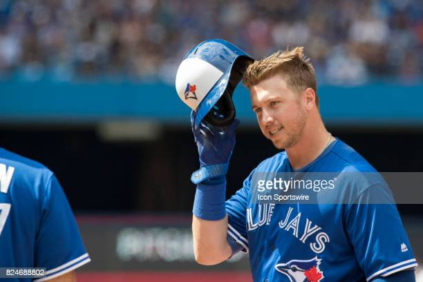 Toronto Blue Jays First baseman Justin Smoak takes off his batting hat during the regular season MLB game between the Los Angeles Angels of Anaheim...