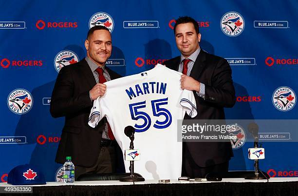 TORONTO ON NOVEMBER 20 Toronto Blue Jays general manager Alex Anthopoulos introduces newly acquired catcher Russell Martin at press conference atbthe...