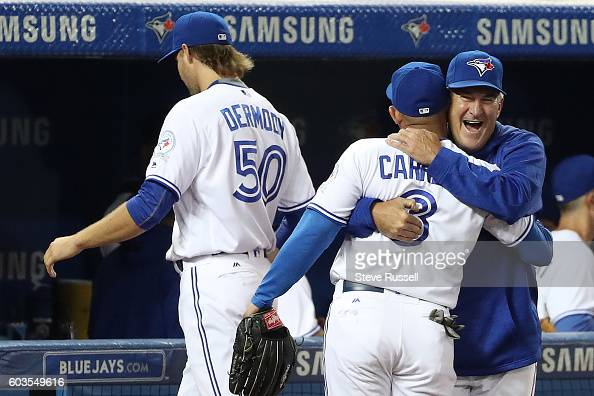 TORONTO ON SEPTEMBER 12 Toronto Blue Jays hitting coach Brook Jacoby hugs Ezequiel Carrera who had the Jays winning home run as the Toronto Blue Jays...