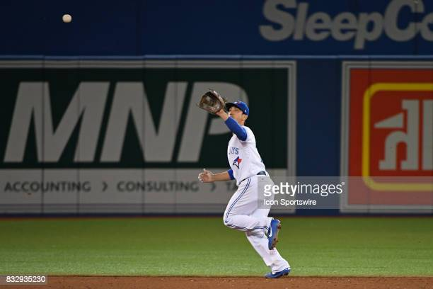 Toronto Blue Jays Infield Darwin Barney chases down an infield fly ball during the regular season MLB game between the Tampa Bay Rays and Toronto...