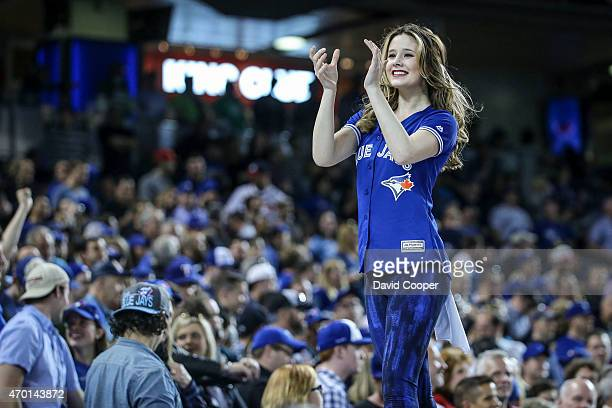 TORONTO ON APRIL 17 Toronto Blue Jays JForce member leads the crowd in singing 'Take me out to the ballgame Toronto Blue Jays lost 87 to the Atlanta...