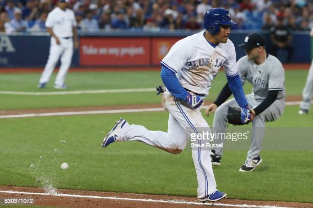 TORONTO ON AUGUST 10 Toronto Blue Jays left fielder Ezequiel Carrera kicks up chalk as he tries to leg out a bunt moving the runner on base over as...