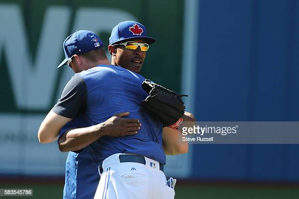 TORONTO ON JULY 26 Toronto Blue Jays left fielder Melvin Upton Jr greets a Michael Saunders He watched the game from the visitors dugout last night...