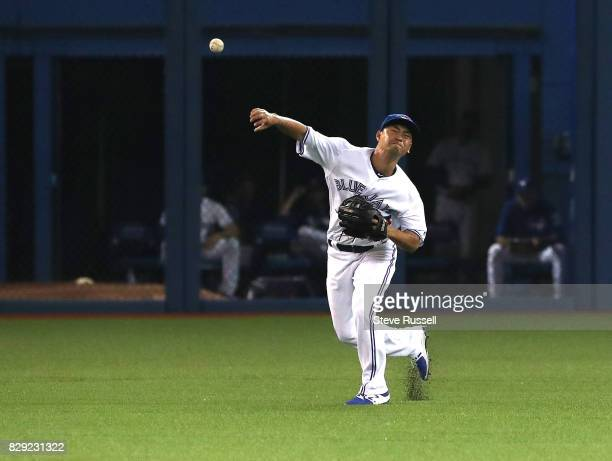 TORONTO ON AUGUST 9 Toronto Blue Jays left fielder Norichika Aoki guns out Ronald Torreyes at the plate as the Toronto Blue Jays lose to the New York...