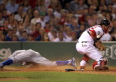 Toronto Blue Jays left fielder Rajai Davis slides safely home before the throw to Boston Red Sox catcher Jarrod Saltalamacchia during the seventh...