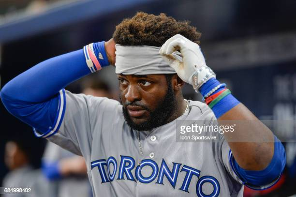 Toronto Blue Jays outfielder Dwight Smith adjusts his headband during a game between the Atlanta Braves and Toronto Blue Jays on May 18 2017 at...