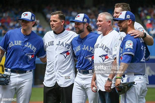 TORONTO ON AUGUST 14 Toronto Blue Jays past and present Brett Cecil Pat Hentgen RA Dickey Dave Stieb Roy Halladay and Marco Estrada pose for pictures...