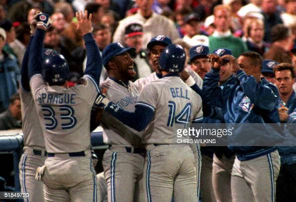 Toronto Blue Jays pinch hitter Ed Sprague is congratulated 18 October 1992 in Atalnta GA by teammates after he hit a tworun homerun in the eigth...