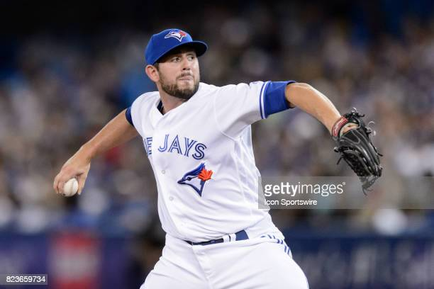 Toronto Blue Jays Pitcher Dominic Leone throws a pitch during the MLB regular season game between the Toronto Blue Jays and the Oakland Athletics on...