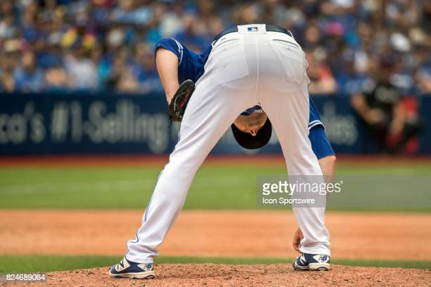 Toronto Blue Jays Pitcher Joe Smith adjusts his pants during the regular season MLB game between the Los Angeles Angels of Anaheim and the Toronto...