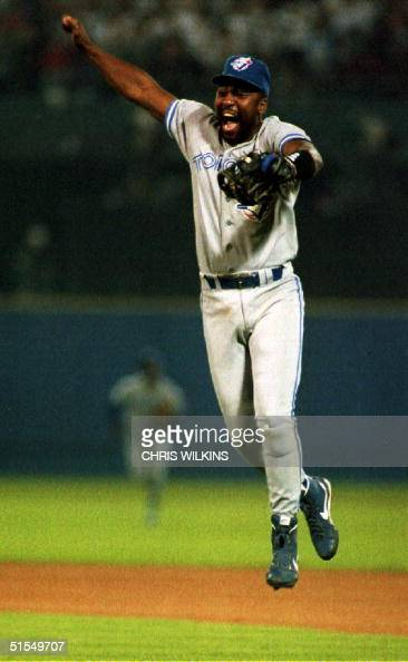 Toronto Blue Jays player Joe Carter leaps into the air 25 October 1992 in Atlanta GA after the Blue Jays defeated the Atlanta Braves 43 to capture...