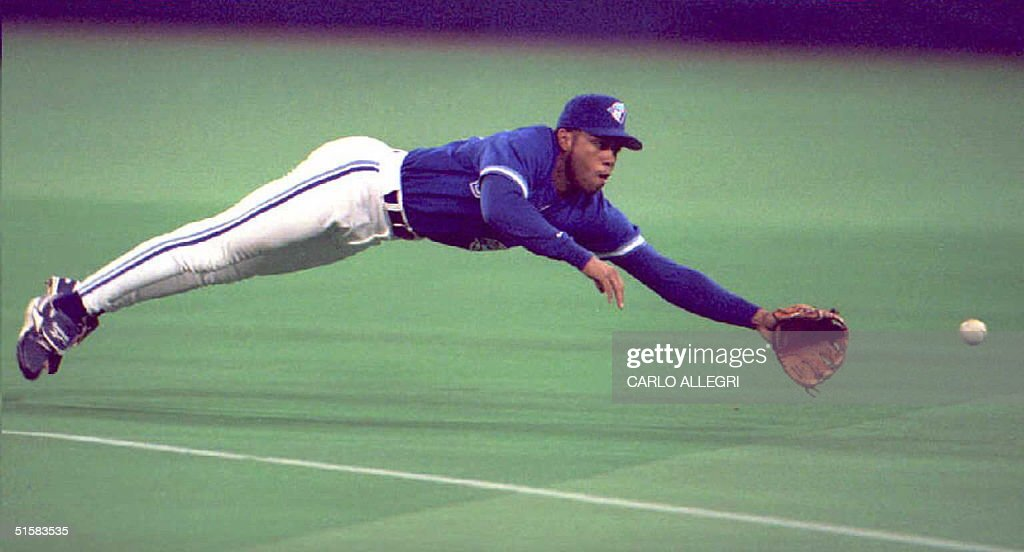 Toronto Blue Jays' player Roberto Alomar dives and misses a hit single by California Angels player Chili Davis in the second inning 30 April at the Toronto Skydome. The Angels defeated the Blue Jays, 5-3.