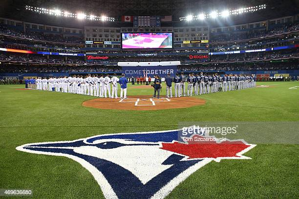 Toronto Blue Jays players and Tampa Bay Rays players line up during the playing of the Canadian anthem before the start of MLB game action on April...