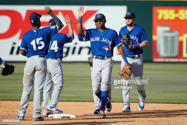 Toronto Blue Jays players celebrate following a Grapefruit League spring training game against the Pittsburgh Pirates at McKechnie Field on February...