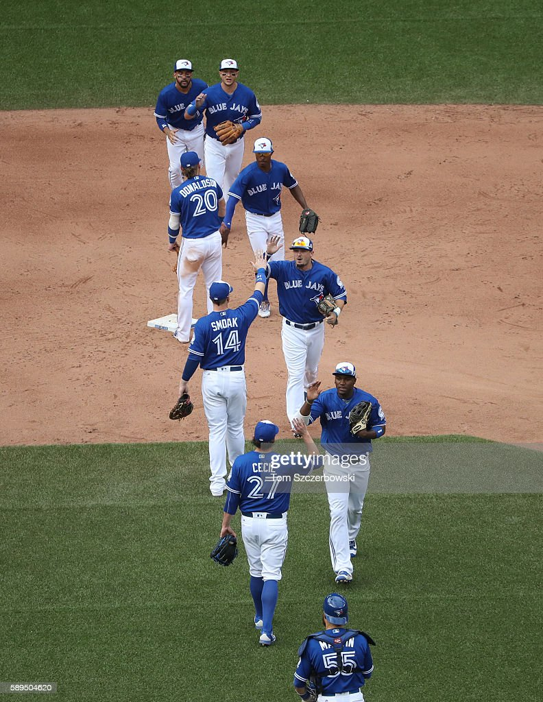 Toronto Blue Jays players celebrate their victory against the Houston Astros in MLB game action on August 14, 2016 at Rogers Centre in Toronto, Ontario, Canada.