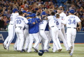 Toronto Blue Jays players celebrate their victory in the ninth inning during MLB game action against the Tampa Bay Rays on May 28 2014 at Rogers...