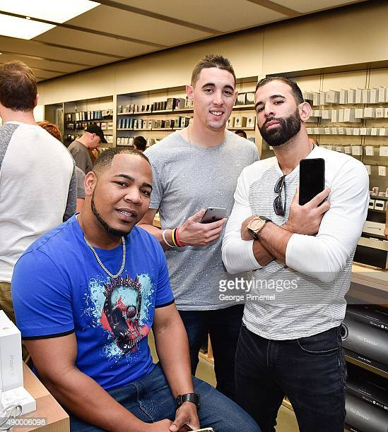 Toronto Blue Jays players Edwin Encarnacion Aaron Sanchez and Jose Bautista stop by Apple Store Eaton Centre in Toronto for new iPhone 6s and iPhone...