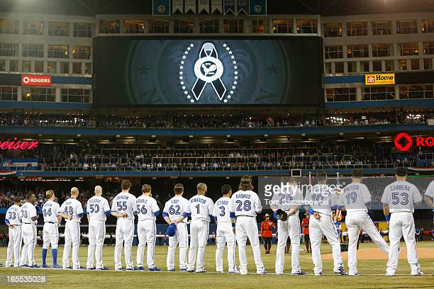 Toronto Blue Jays players observe a moment of silence in honor of the shooting victims in Newtown Connecticut before the start of MLB game action on...