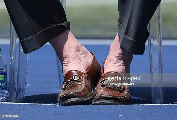Toronto Blue Jays president Paul Beeston reveals his trademark lack of socks as he attends a pregame ceremony for former player Carlos Delgado of the...