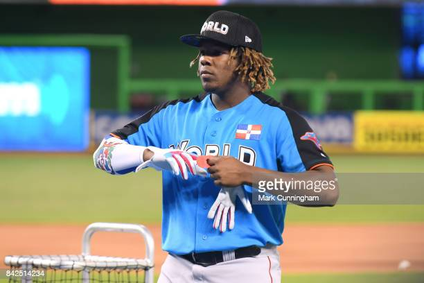 Toronto Blue Jays prospect Vladimir Guerrero Jr #27 of the World Team looks on prior to the 2017 SiriusXM AllStar Futures Game at Marlins Park on...