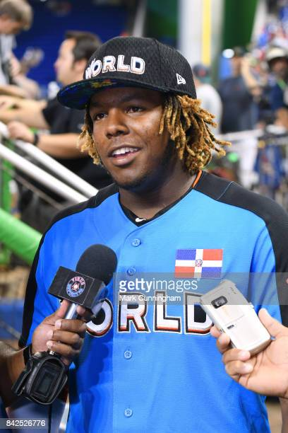 Toronto Blue Jays prospect Vladimir Guerrero Jr #27 of the World Team talks with reporters prior to the 2017 SiriusXM AllStar Futures Game at Marlins...