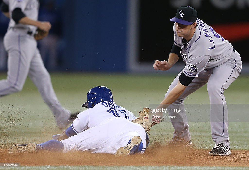 Toronto Blue Jays Rajai Davis slides in safe in the seventh as Colorado Rockies second baseman D.J. Le Mahieu does not make the tag.
