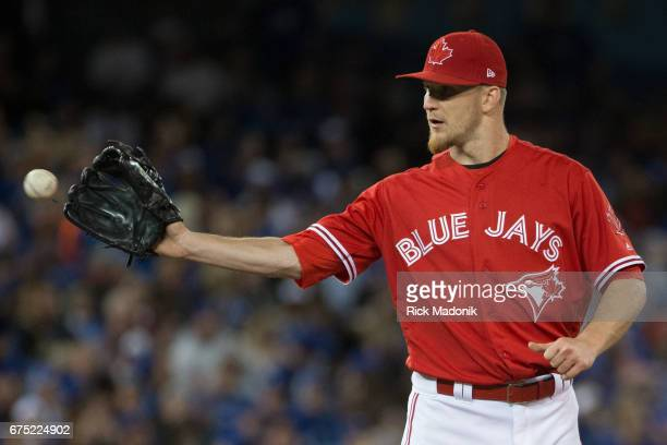 Toronto Blue Jays relief pitcher Dominic Leone catches a ball back from catcher Russell Martin Toronto Blue Jays Vs Tampa Bay Rays in MLB regular...
