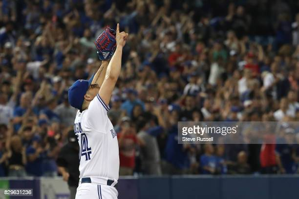 TORONTO ON AUGUST 10 Toronto Blue Jays relief pitcher Roberto Osuna points skyward after recording the final out as the Toronto Blue Jays shutout the...