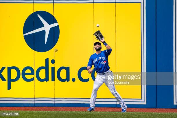Toronto Blue Jays Right fielder Jose Bautista catches a pop up during the regular season MLB game between the Los Angeles Angels of Anaheim and the...