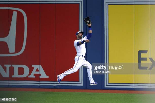 TORONTO ON MAY 26 Toronto Blue Jays right fielder Jose Bautista makes a running and leaping catch on Texas Rangers second baseman Rougned Odor for...