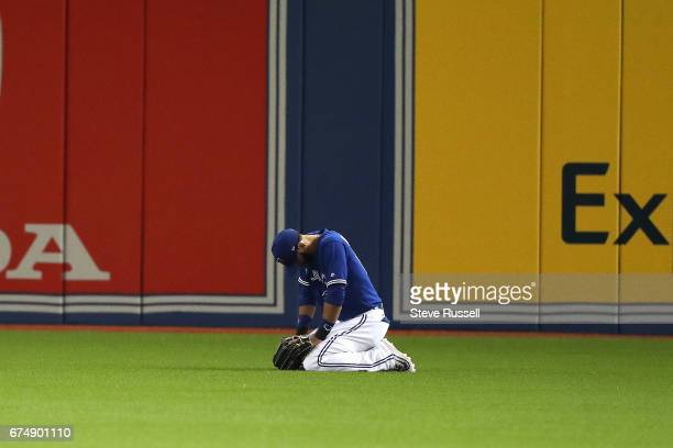 TORONTO APRIL 29 Toronto Blue Jays right fielder Jose Bautista reacts after replay reverses his outfield assist on a play at the plate as the Toronto...