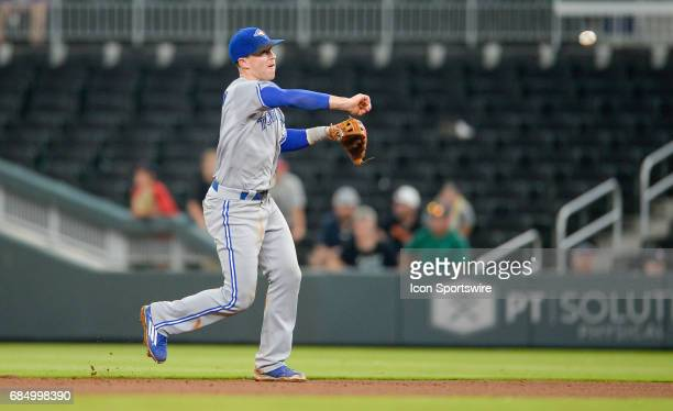 Toronto Blue Jays second baseman Chris Coghlan throws to first base for the final out during a game between the Atlanta Braves and Toronto Blue Jays...