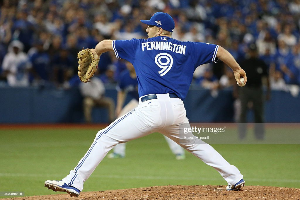 Toronto Blue Jays second baseman Cliff Pennington pitches in the ninth inning The Toronto Blue Jays and the Kansas City Royals play game four of the...