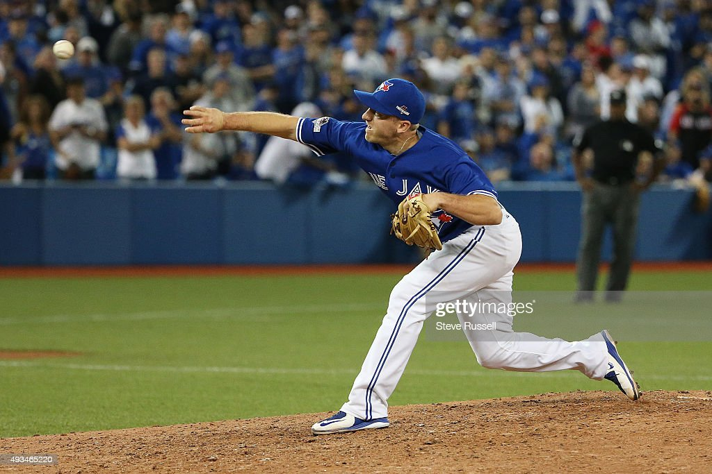 Toronto Blue Jays second baseman Cliff Pennington pitches the last out of the ninth inning The Toronto Blue Jays and the Kansas City Royals play game...