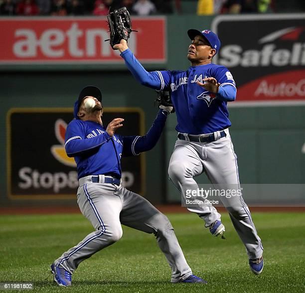 Toronto Blue Jays second baseman Devon Travis and Toronto Blue Jays right fielder Ezequiel Carrera narrowly avoid a collision as a short fly ball hit...
