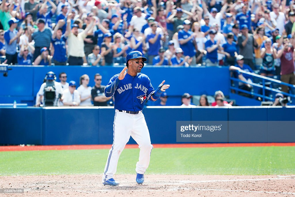 Toronto Blue Jays second baseman Devon Travis (29) reacts to his tying run in the bottom of the eighth inning in his game against the Boston Red Sox during their Major League Baseball game at the Rogers Centre in Toronto, Ontario. Toronto Star/Todd Korol