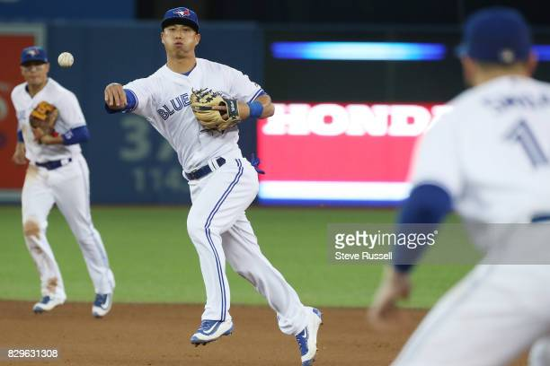TORONTO ON AUGUST 10 Toronto Blue Jays second baseman Rob Refsnyder throws the ball to first base as the Toronto Blue Jays shutout the New York...