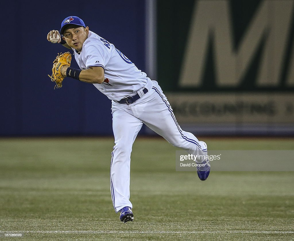 TORONTO, ON - APRIL 19 - Toronto Blue Jays shortstop Munenori Kawasaki (66) charges the ball and throws in the top of the 9th to get New York Yankees shortstop Eduardo Nunez (26) at 1st during the Toronto Blue Jays take on the New York Yankees at The Rogers Centre April 19, 2013.