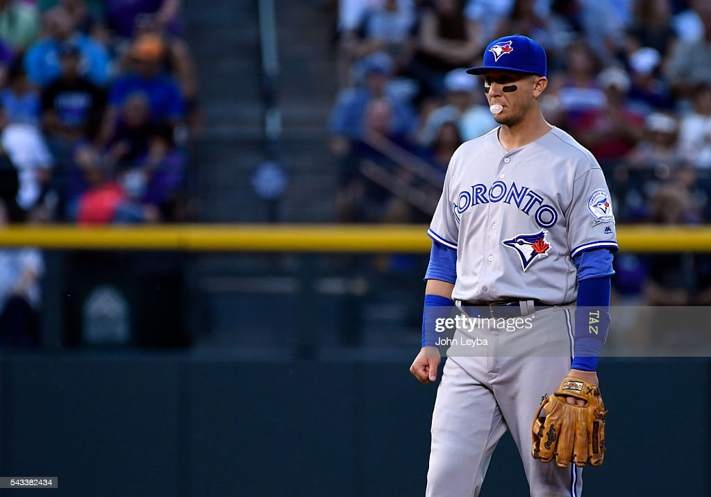 Toronto Blue Jays shortstop <a gi-track='captionPersonalityLinkClicked' href=/galleries/search?phrase=Troy+Tulowitzki&family=editorial&specificpeople=757353 ng-click='$event.stopPropagation()'>Troy Tulowitzki</a> (2) blows a bubble during the sixth inning against the Colorado Rockies June 27, 2016 at Coors Field.