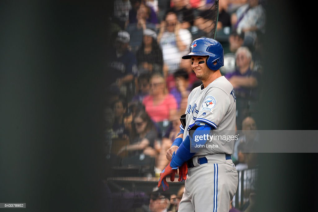 Toronto Blue Jays shortstop <a gi-track='captionPersonalityLinkClicked' href=/galleries/search?phrase=Troy+Tulowitzki&family=editorial&specificpeople=757353 ng-click='$event.stopPropagation()'>Troy Tulowitzki</a> (2) puts on his batting gloves in the on deck circle during the second inning agains the Colorado Rockies June 27, 2016 at Coors Field.