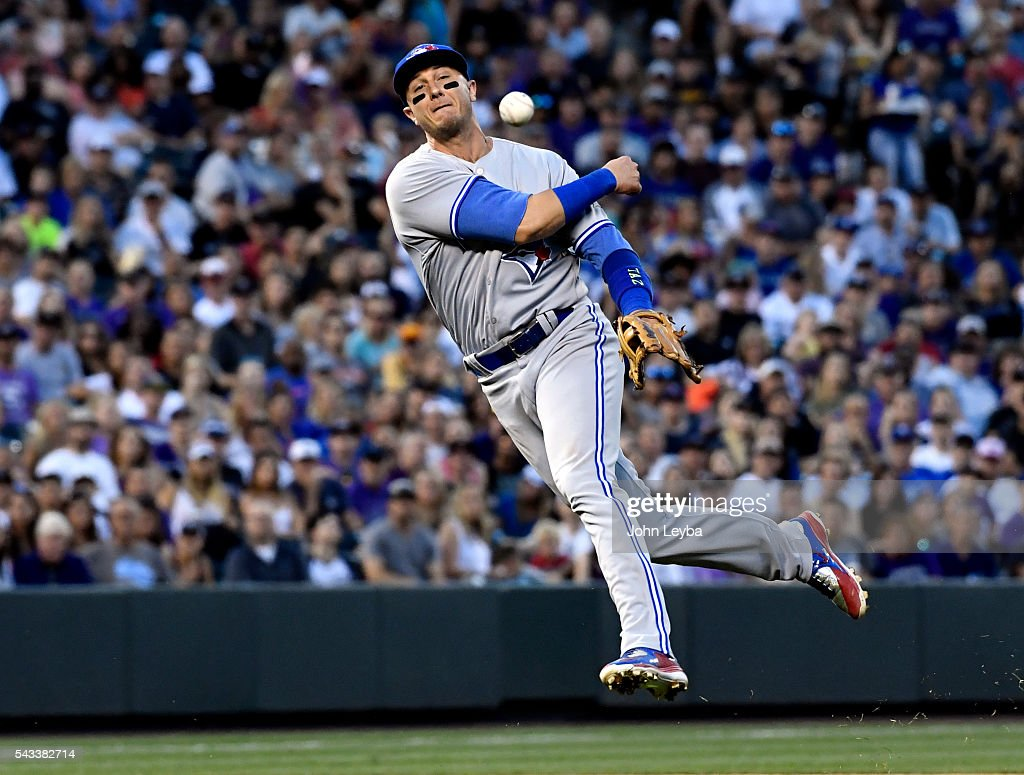 Toronto Blue Jays shortstop <a gi-track='captionPersonalityLinkClicked' href=/galleries/search?phrase=Troy+Tulowitzki&family=editorial&specificpeople=757353 ng-click='$event.stopPropagation()'>Troy Tulowitzki</a> (2) throws out Colorado Rockies catcher Nick Hundley (4) at first base during the sixth inning June 27, 2016 at Coors Field.